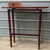 Hall table in jarrah with silver ash drawer and ebony details